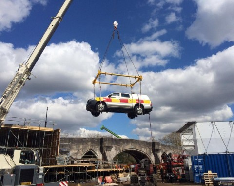 Modulift Spreader Frame Lifts Vehicle for Filming Project